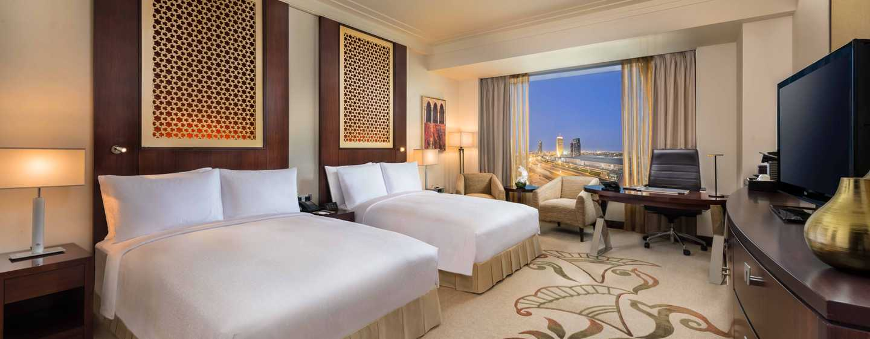 Hotel Conrad Dubai, Emirati Arabi Uniti - Camera Deluxe con due letti matrimoniali e vista sullo skyline
